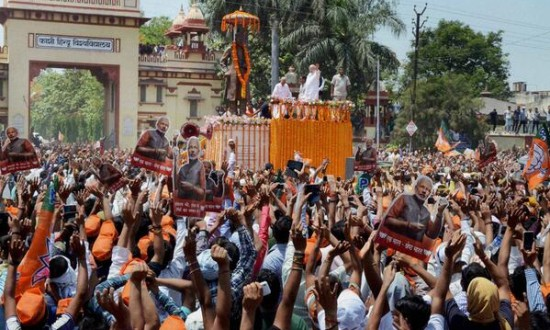 Cheered by thousands, Modi sets out to file nomination