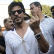 Actor Shahrukh Khan shows his fore finger marked with phosphorous ink after casting his vote at a polling booth during the sixth phase of 2014 Lok Sabha Polls  in Mumbai on April 24, 2014. (Photo: Sandeep Mahankal/IANS)