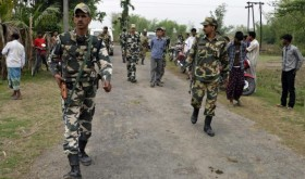 Indian security personnel patrol the attack-hit area of the Balapara village in Assam