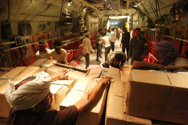SHIB1056-relief materials beinmg loaded inside C-130J aircraft