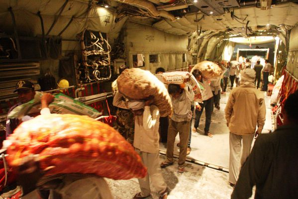 SHIB1099-relief materials beinmg loaded inside C-130J aircraft